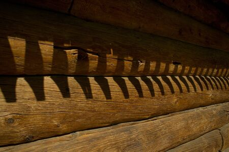 Detail of Russian log hut: a timbered wall, background photo