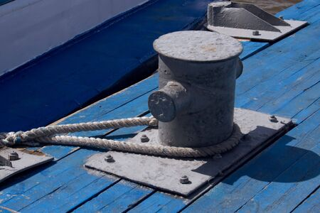 moorings: Fastening of a mooring cable on old quay Stock Photo