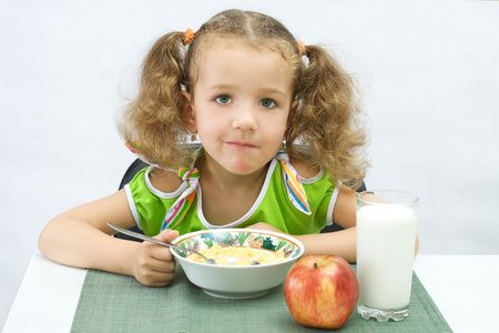 The girl has breakfast corn flakes with milk Stock Photo - 1950284