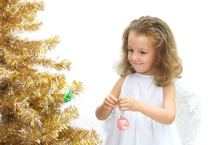 The girl - angel decorating a christmas tree
