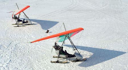 diagonals: Two hang-gliders on winter lake