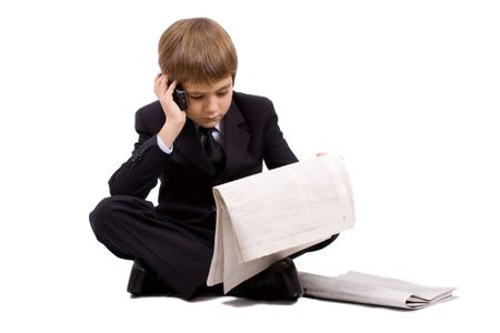 Boy in a business suit with a newspaper and phone, isolated over white Stock Photo