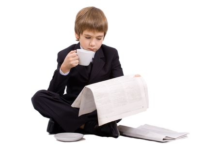 Boy in a business suit with a cup, isolated over white photo