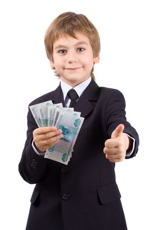 Boy in a business suit, holds  money in hands, isolated over white Stock Photo