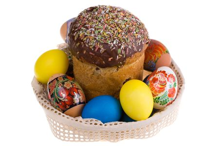 Celebratory dish with easter eggs and cake, isolatad  photo