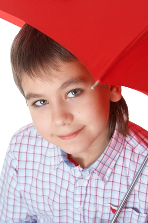 Boy with red umbrella, over white over white