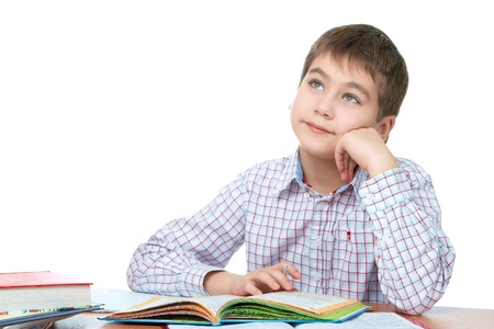schoolwork: Boy and boring schoolwork, over white isolated over white