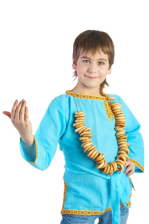 The boy in Russian national shirt c with a bread ring, isolated isolated over white
