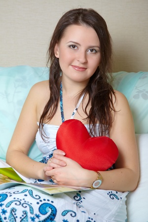 Portrait of the girl with red heart Stock Photo - 9355581