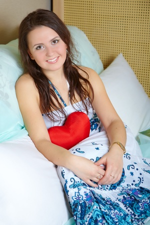 Portrait of the girl with red heart Stock Photo - 9355585