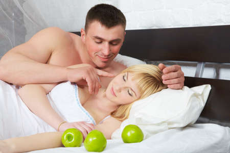 Boyfriend looking at his girlfriend who is sleeping  Stock Photo