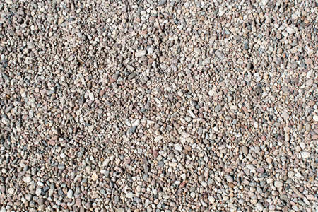 Gravel texture Small stones, little rocks, pebbles in many shades of grey, white, brown, pink colour. Crushed granite texture. Road made of stones from river or lake Small rock background