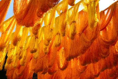gold souk: Gold Silk Strands Drying in the Sun in A Moroccan Souk