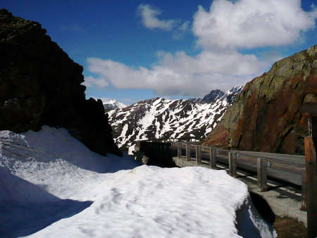 about you: On the way to Aosta. You can good see the high snow wall on the left side. This pass is about 2400 m above sea level and its mid of June