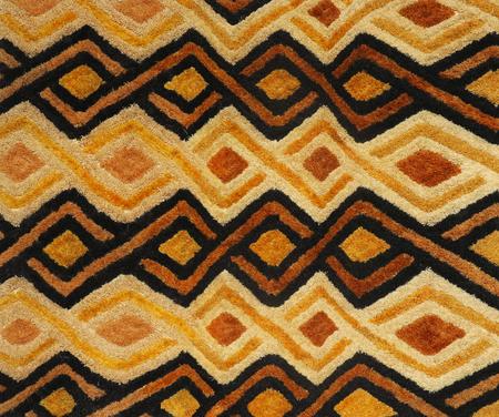 Bushman straw carpet with geometric v shaped ornament