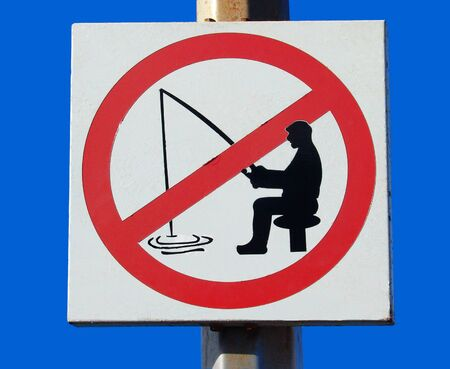 Sign Forbidden to fish in a port on Tenerife island Stock Photo