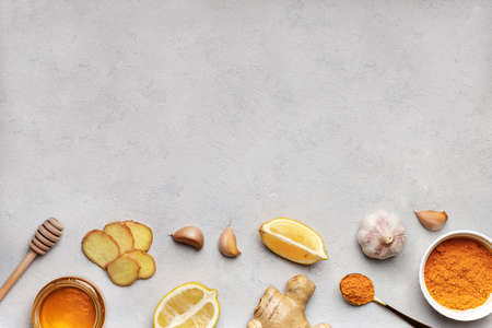 Set of products for making beverages on white background. Ingridient for drinks to support immune system and prevent diseases turmeric, honey, ginger and lemon. Herbal medicine. Copy space, flat lay. Stok Fotoğraf