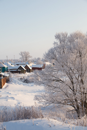 winter view of traditional wooden houses in Russia