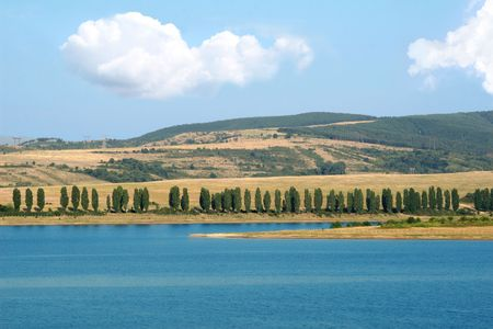 eminence: summer landscape with lake, many trees and fields