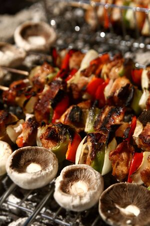 barbecue with delicious grilled meat on grill photo