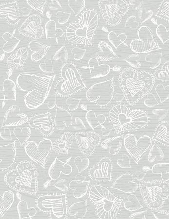 garabatos: fondo gris de madera con mano dibujar corazones