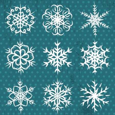 hand made snowflakes on blue background Vector