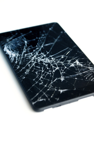 Picture of cracked display on a tablet isolated on white. Tablet with damaged screen