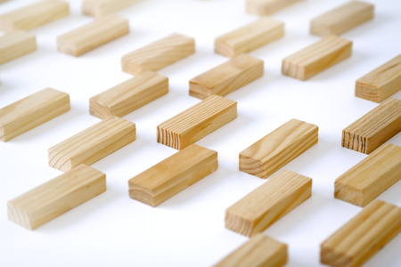 Wooden rectangles arranged differently over a white background. Copy space.Cover background template for the presentation, brochure, web, banner, catalog, poster, book, magazine