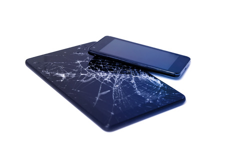 Photos of cracked display on a tablet and black cellphone isolated on white. Tablet with damaged screen.