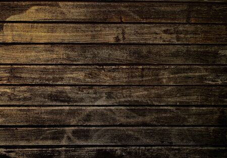 Rustic wall made of brown wooden planks. Natural background. Wood texture for design and decoration