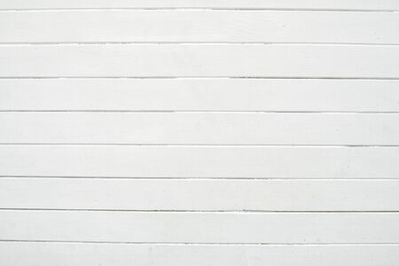 Wood white texture for design and decoration. New wall made of wooden planks. Close up of wall of wooden planks