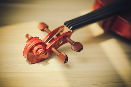 Closeup shot of violin which could be music background.