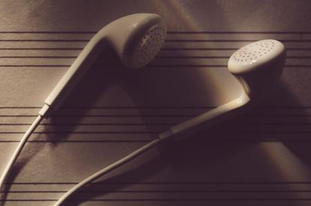 Earphones on the sheet music Stock Photo