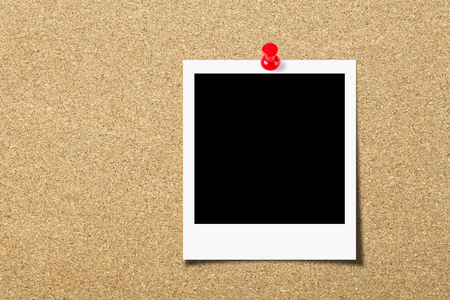 Blank photo pinned on the cork board