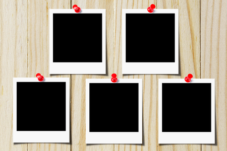 Blank photo pinned on the wooden wall Stock Photo