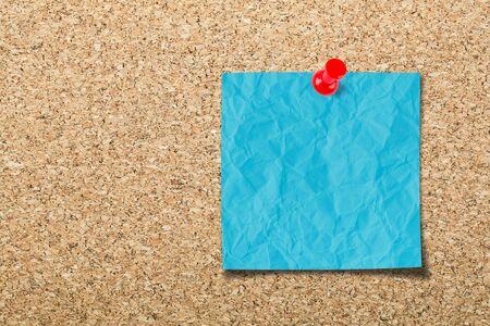 Blank sticky note on cork board Stock Photo