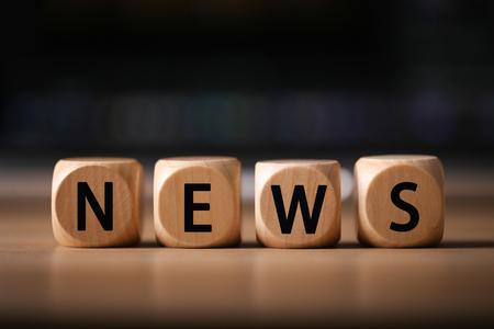 Close-up Shot of news wooden blocks.