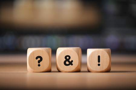 Close-up Shot of Question And Answer wooden blocks.