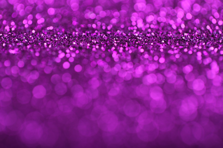 Abstract background of purple glittering defocused lights. Фото со стока