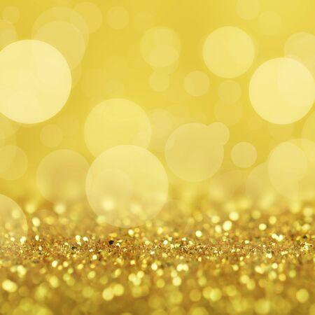 Abstract background of golden glittering defocused lights.