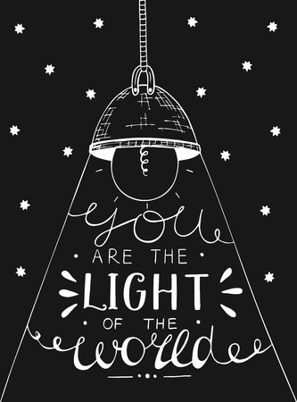 saintly: Hand lettering You the light of the world, made on black star background with glowing light bulb. Biblical background. Christian poster. New Testament Illustration