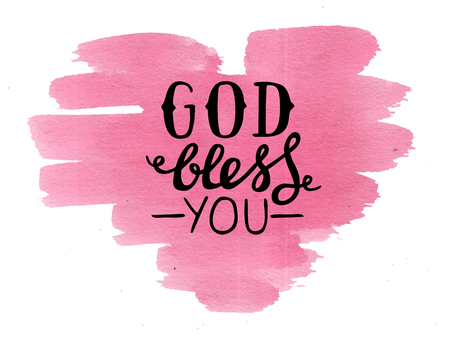Hand lettering God bless you made on pink watercolor heart. Christian poster. Card. Congratulations. Modern calligraphy. Scripture print