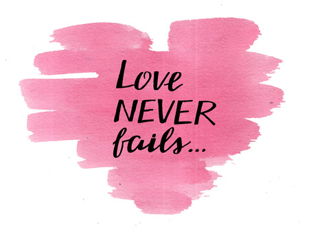 Hand lettering Love never fails, made on watercolor pink heart. Christian Poster. Biblical background. Declaration of love. Valentine s day. Scripture print. Card. Corinthians. Wedding