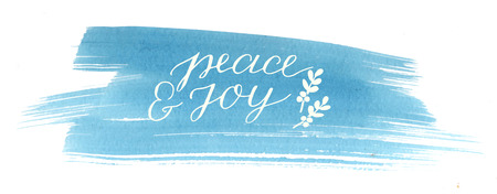 Holiday card with inscription Peace and joy, made hand lettering on blue watercolor background