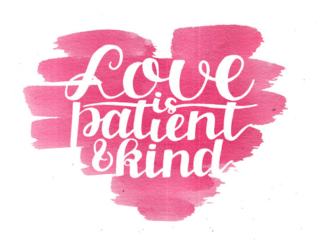 Hand lettering Love is patient and kind on watercolor pink heart Stock Photo