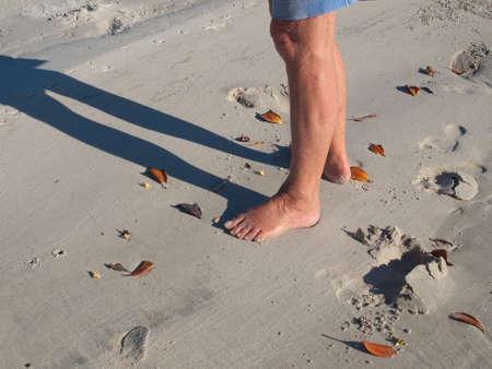 bare feet: Ladys bare feet and footprints on a white sandy tropical beach.Photo taken on Frazer Island, Queensland, Australia.