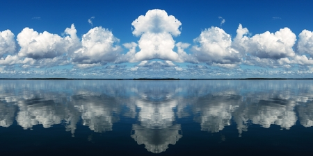 Multiple clouds with sea water reflactions. Australia East Coast.cloud, clouds, reflections, water, sea, ocean, panorama, cloudy, scene, scenic, view, bright clouds, sky, coast, coastal, sky art, skyscape, colour, color, colourful, blue, white, cloudscape