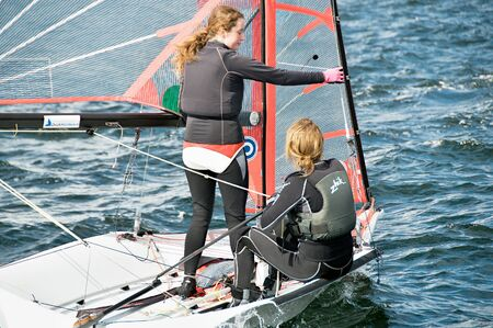 Lake Macquarie, Australia - April 16. 2013: Children competing in the Australian Combined High School Sailing Championships. Young contestants raced in various types of dinghies. Editorial