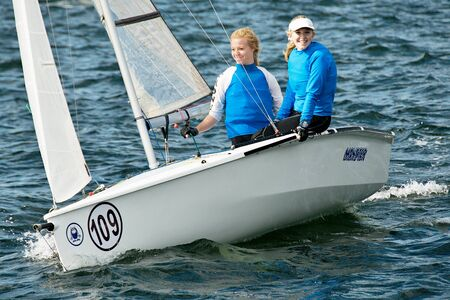 Children competing in the Australian Combined High School Sailing Championships 2013. Lake Macquarie. Australia. Young contestants raced in various types of dinghies.