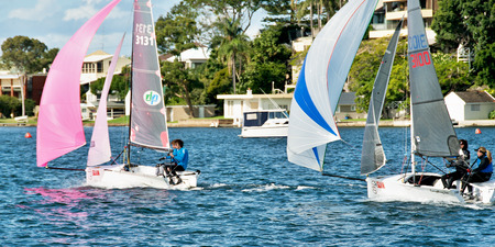 Lake Macquarie, Australia - April 17. 2013: Children competing in the Australian Combined High School Sailing Championships. Young contestants raced in various types of dinghies.
